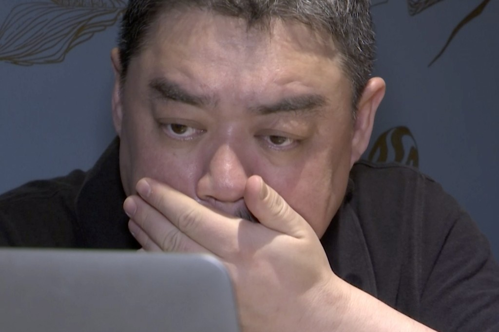 In this image taken from video footage shot on May 22, 2019, Wu'er Kaixi reacts while looking at photos from the 1989 protest during an interview in T...