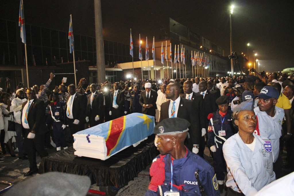 The coffin carrying the remains of longtime Congolese opposition leader Etienne Tshisekedi arrives at Kinshasa airport Thursday, May 30, 2019. The bod...