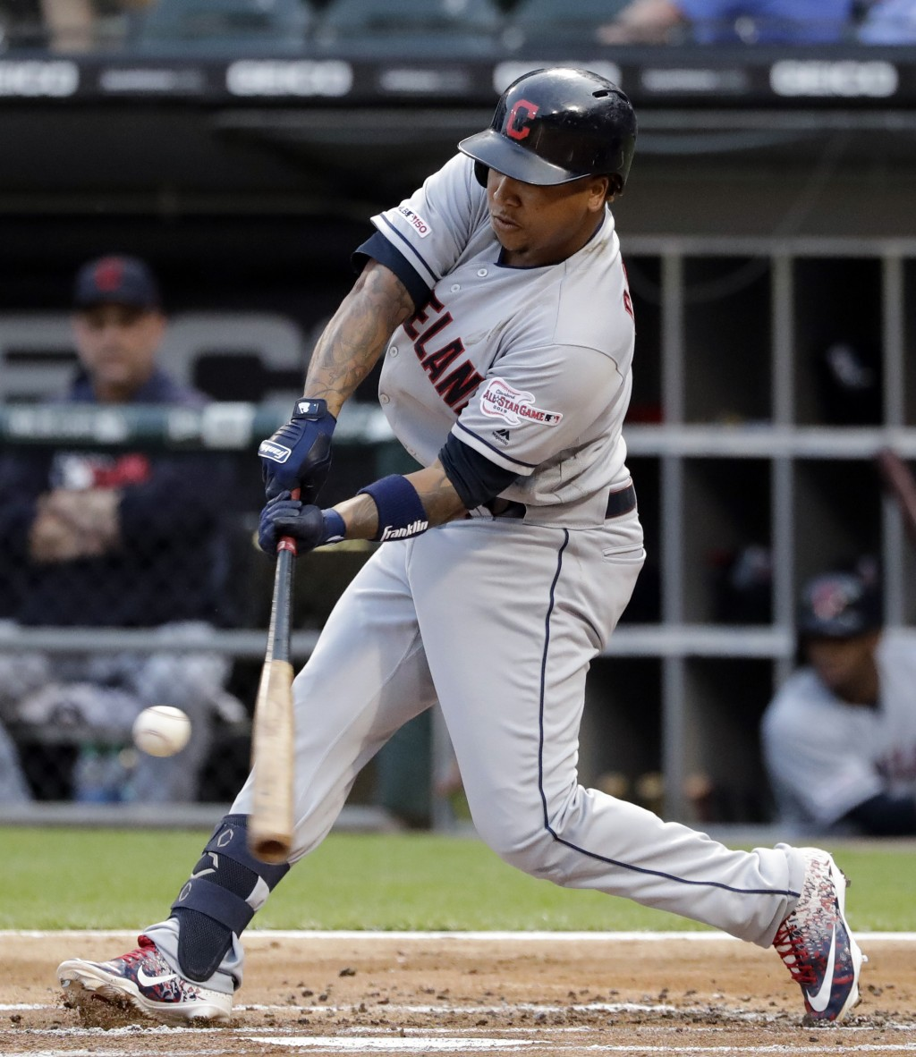Cleveland Indians' Jose Ramirez hits a double against the Chicago White Sox during the first inning of a baseball game in Chicago, Friday, May 31, 201