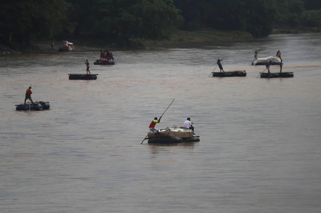Rafts criss-cross the Suchiate river on the Guatemala – Mexico border, near Ciudad Hidalgo, Mexico, early Friday, May 31, 2019. Migrants are increasin...