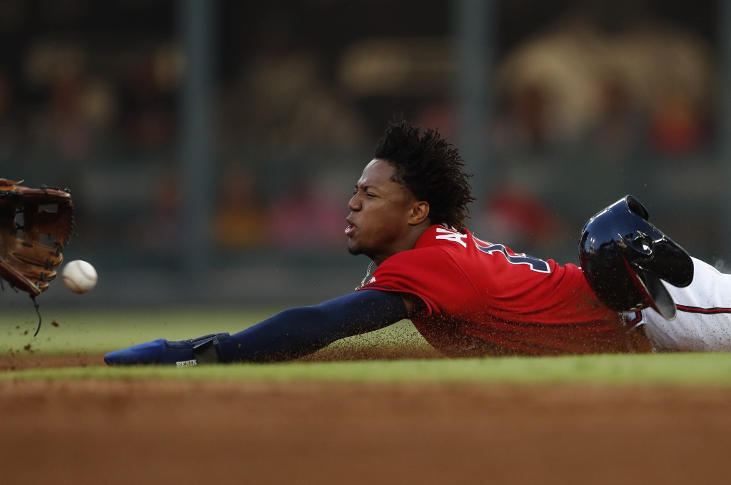 Atlanta Braves' Ronald Acuna Jr. steals second base in the third inning of a baseball game against the Detroit Tigers Friday, May 31, 2019, in Atlanta...
