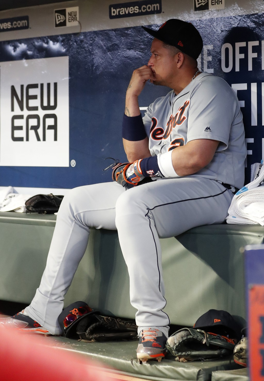 Detroit Tigers first baseman Miguel Cabrera sits in the dugout before being replaced in the lineup during the seventh inning of a baseball game agains...