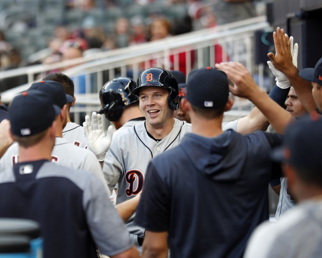 Detroit Tigers catcher Grayson Greiner celebrates in the dugout after hitting a solo-home run in the first inning of a baseball game Atlanta Braves, F...