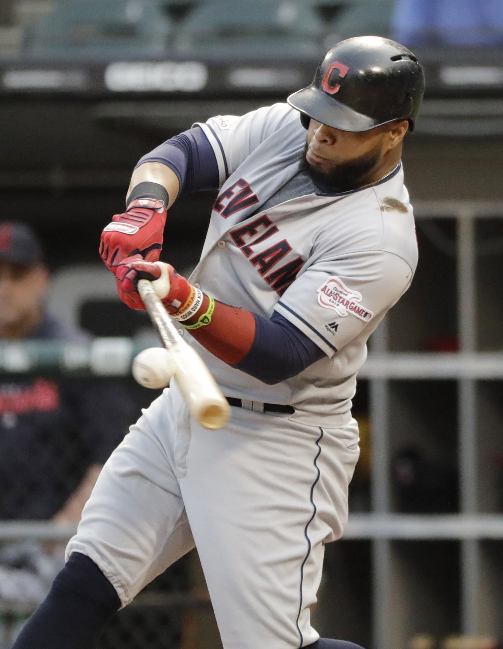 Cleveland Indians' Carlos Santana hits a single against the Chicago White Sox during the first inning of a baseball game in Chicago, Friday, May 31, 2