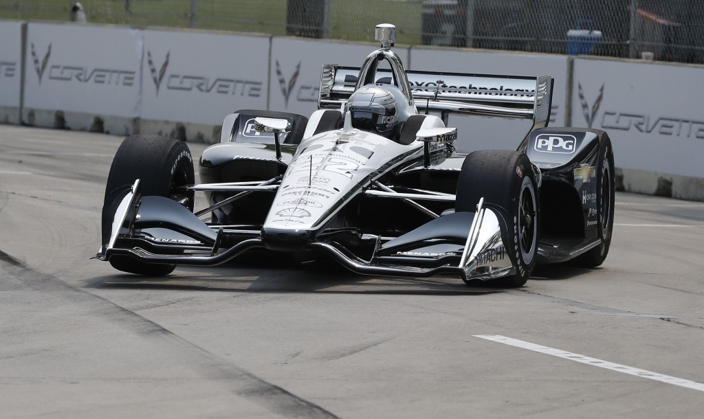 Simon Pagenaud, of France, rounds the seventh turn during practice for the first race of the IndyCar Detroit Grand Prix auto racing doubleheader, Frid...