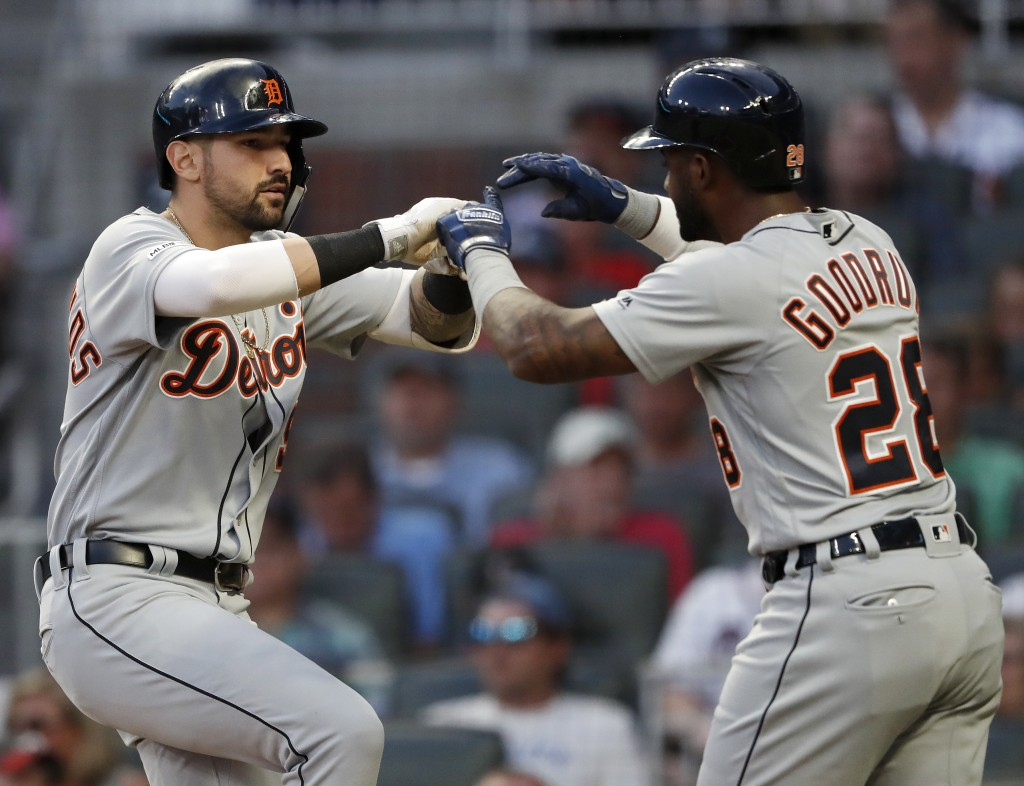 Detroit Tigers right fielder Nicholas Castellanos, left, celebrates with Niko Goodrum (28) after they scored on Castellanos 's two-run home run in the