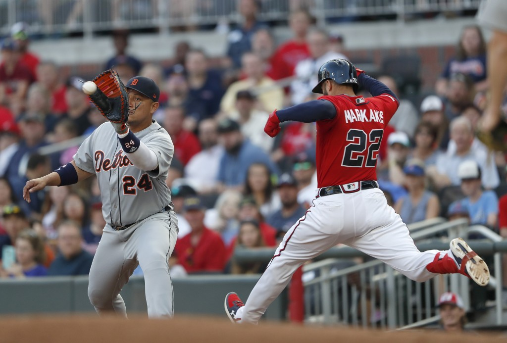 Atlanta Braves' Nick Markakis (22) is out at first base by Detroit Tigers first baseman Miguel Cabrera (24) after hitting a ground ball in the first i...