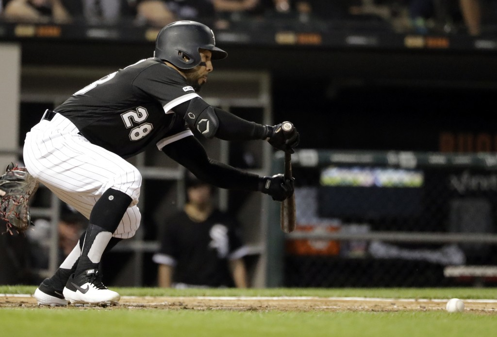 Chicago White Sox's Leury Garcia hits a sacrifice bunt against the Cleveland Indians during the fourth inning of a baseball game in Chicago, Friday, M