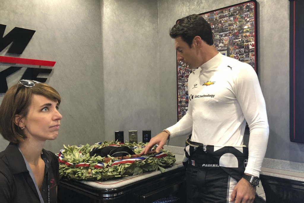 Indianapolis 500 champion Simon Pagenaud looks at the wreath he won less than a week ago and lamented seeing the leaves and orchids wilting, Friday, M