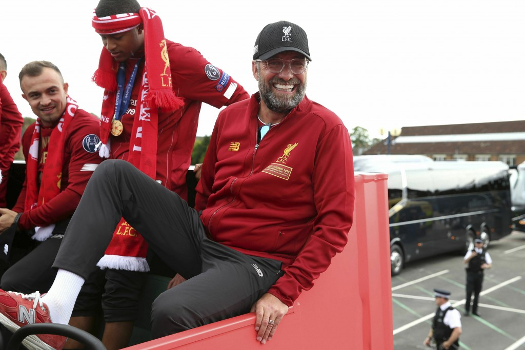 Liverpool soccer team manager Jurgen Klopp, rides an open top bus during the Champions League Cup Winners Parade in Liverpool, England, Sunday June 2,