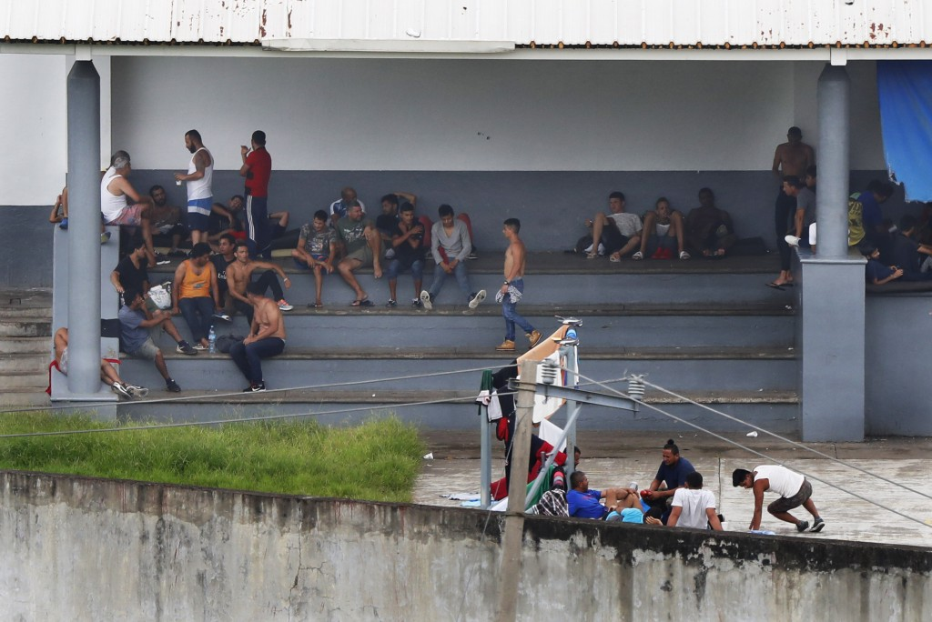 Migrants sit in a courtyard of a migrant detention center in Tapachula, Mexico, Saturday, June 1, 2019. President Donald Trump threaten a 5% tariff on...