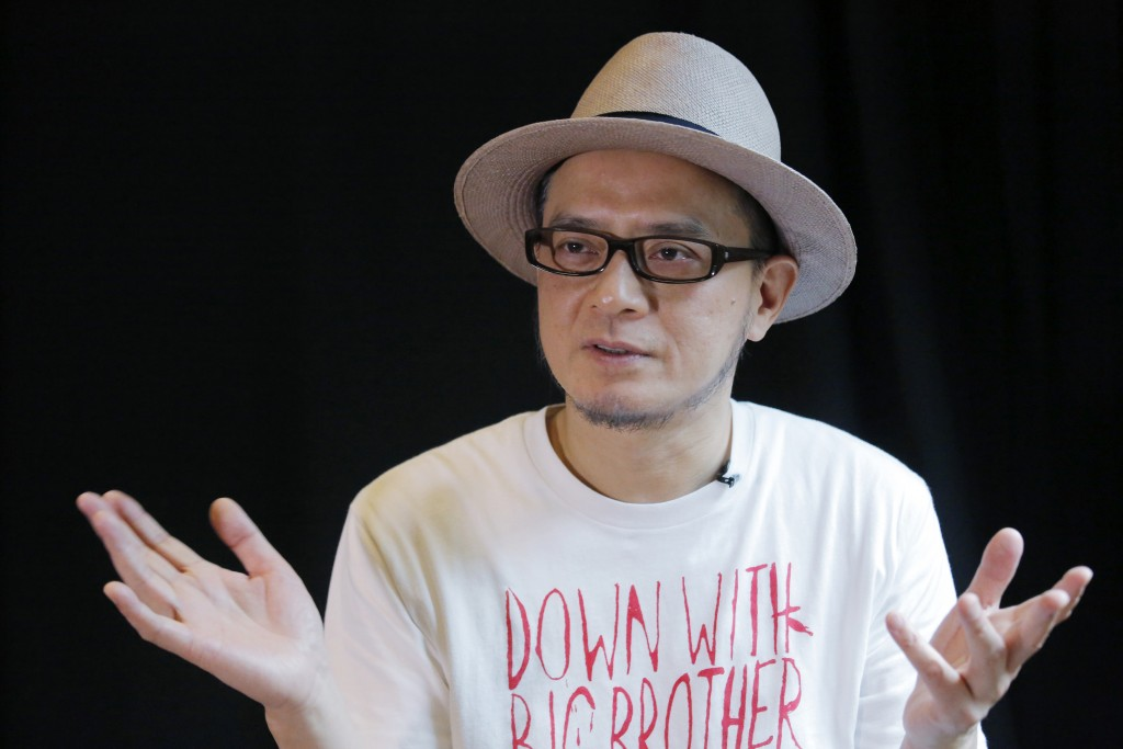 In this Saturday, June 1, 2019, photo, Hong Kong singer Anthony Wong speaks during an interview in Hong Kong. Thirty years after it was crushed by Chi...