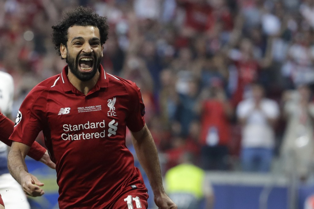 Liverpool's Mohamed Salah celebrates after scoring his side's opening goal during the Champions League final soccer match between Tottenham Hotspur an
