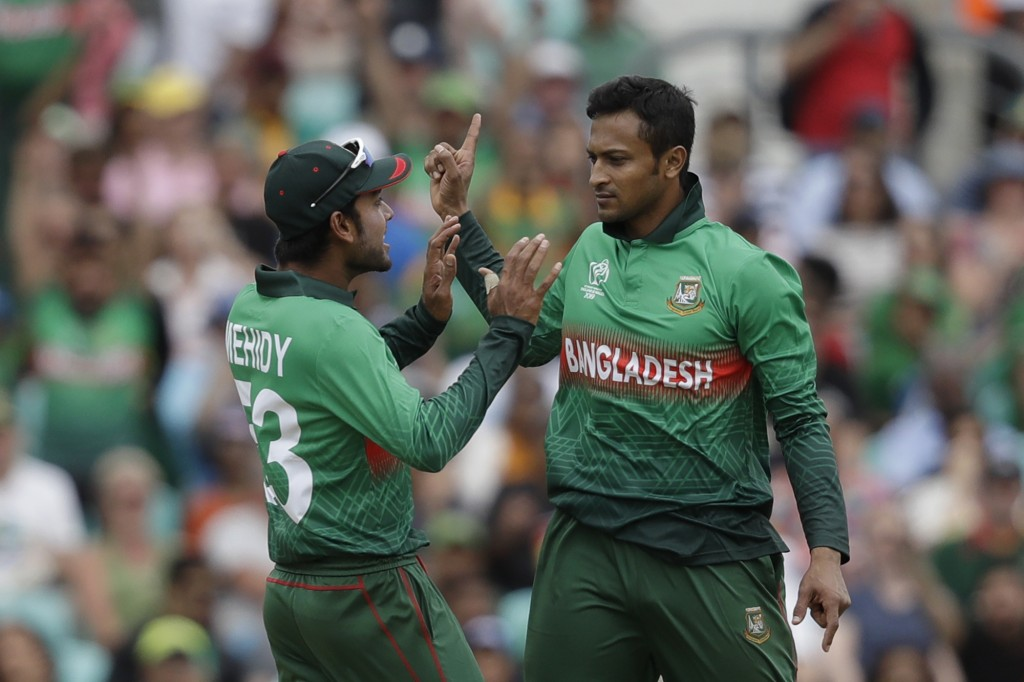 Bangladesh's Shakib Al Hasan, right, celebrates taking the wicket of South Africa's Aiden Markram with Bangladesh's Mehedi Hasan during the Cricket Wo...