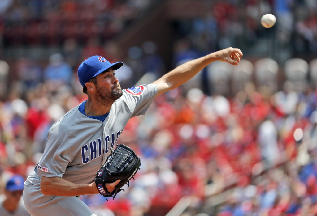 Chicago Cubs starting pitcher Cole Hamels throws during the first inning of a baseball game against the St. Louis Cardinals Sunday, June 2, 2019, in S...