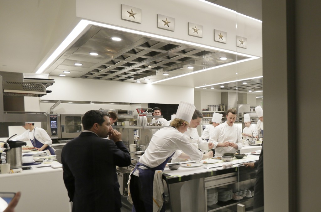 FILE - In this March 9, 2017, file photo, general manager Michael Minnillo watches over dinner service in the kitchen of the French Laundry restaurant...