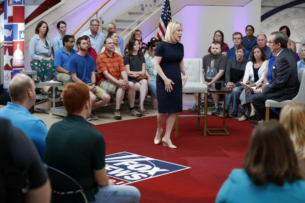 Democratic presidential candidate Sen. Kirsten Gillibrand talks with FOX News Anchor Chris Wallace, right, during a FOX News town hall, Sunday, June 2