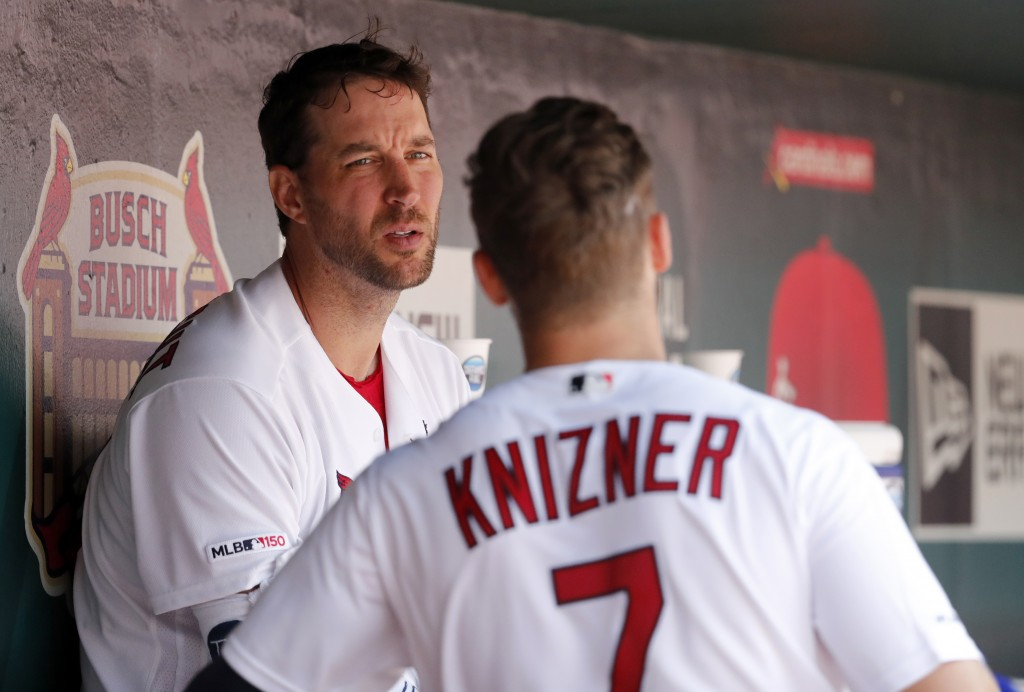 St. Louis Cardinals starting pitcher Adam Wainwright, left, talks in the dugout with catcher Andrew Knizner, right, after working the fifth inning of