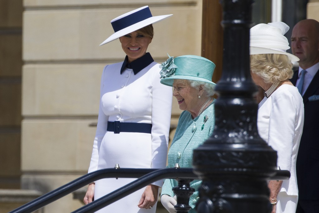 First lady Melania Trump, left, stands with Queen Elizabeth II, and Camilla, Duchess of Cornwall at Buckingham Palace, Monday, June 3, 2019, in London