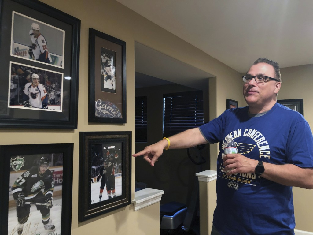 Rob Ferrara points toward photos of his nephew, Patrick Maroon, in his home in St. Louis, Mo., Friday, May 31, 2019. Patrick Maroon had other offers f...