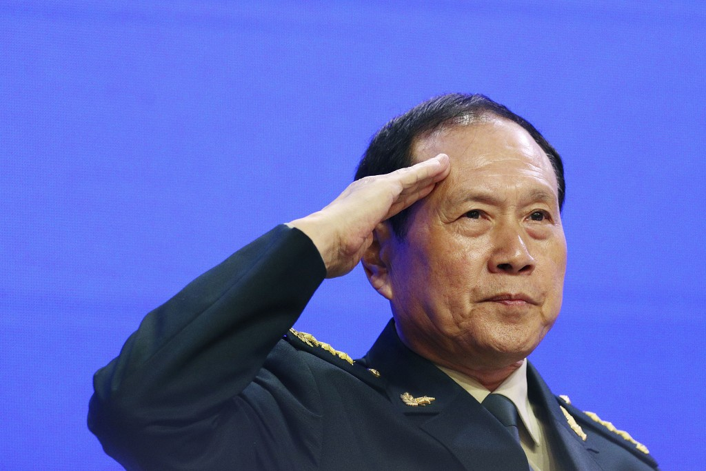 FILE - In this June 2, 2019, file photo, Chinese Defense Minister Gen. Wei Fenghe salutes attendees ahead of the fourth plenary session of the 18th In...