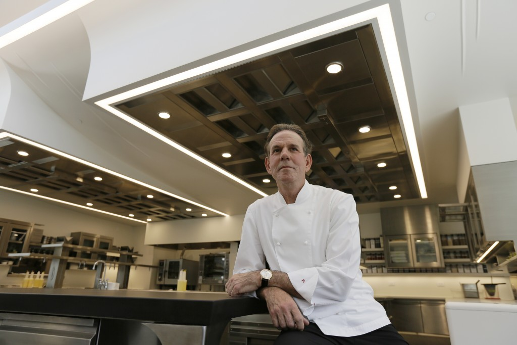 FILE - This March 9, 2017, file photo, shows celebrated chef Thomas Keller in the kitchen of his French Laundry restaurant in Yountville, Calif. A for...