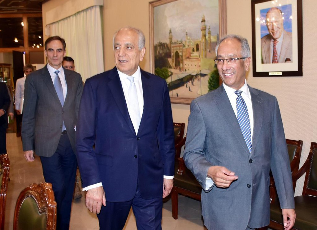 In this photo released by the Foreign Office, Pakistan's Foreign Ministry official Aftab Khokhar, right, escorts visiting Special Representative for A