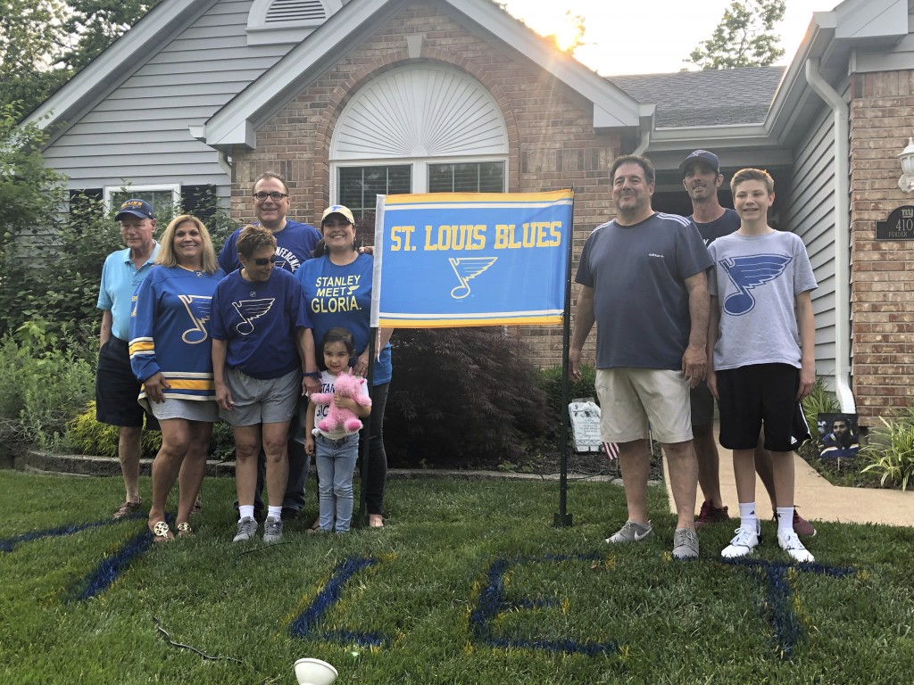 Patrick Maroon's family poses for a photo on the lawn of his uncle Rob Ferrara's house, in St. Louis, Mo., Friday, May 31, 2019. Maroon's mother Patty