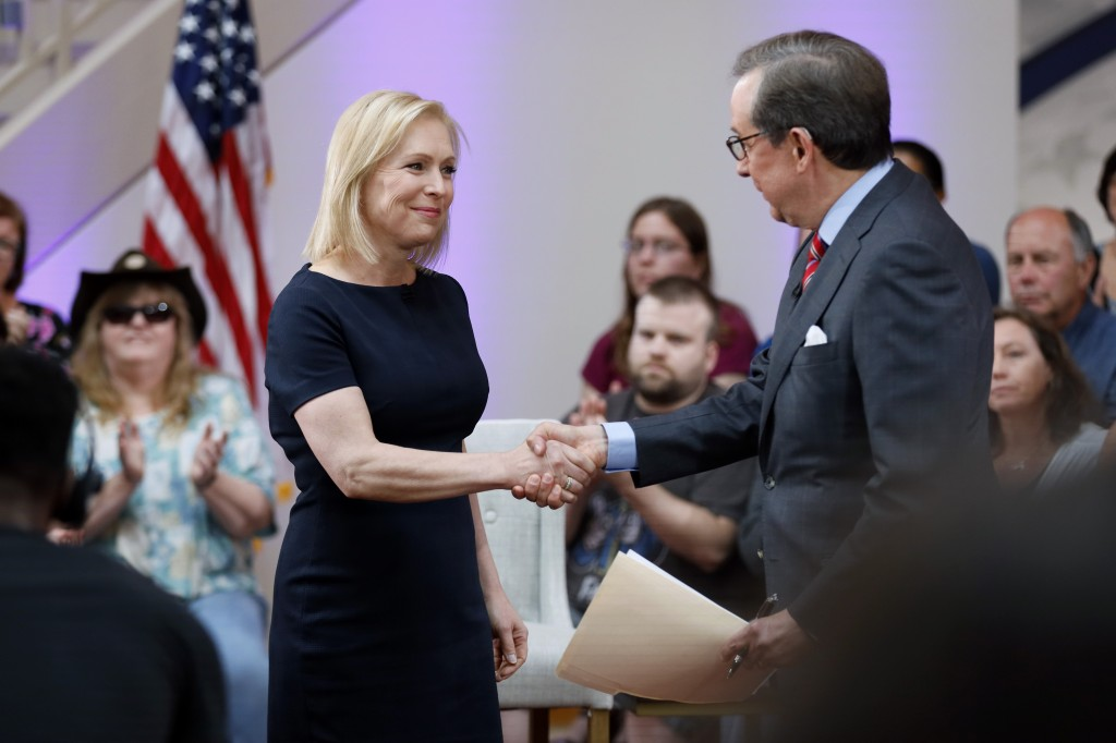 Democratic presidential candidate Sen. Kirsten Gillibrand greets FOX News Anchor Chris Wallace, right, as she arrives at a FOX News town hall, Sunday,