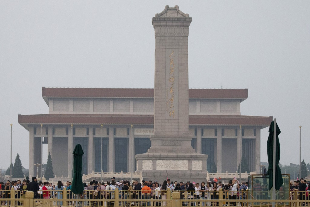 Visitors gather around the Monument to the People's Heroes on Tiananmen Square during the 30th anniversary of a bloody crackdown of pro-democracy prot...