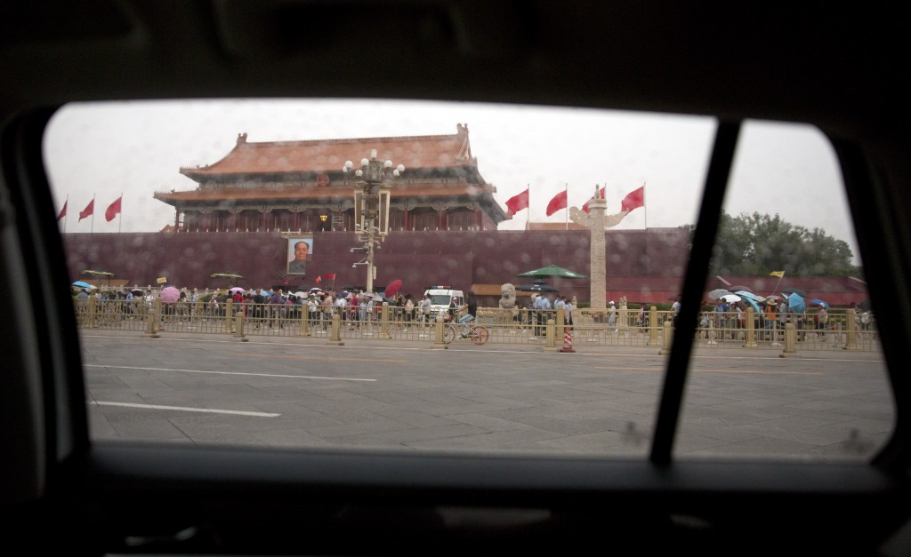 In this Tuesday, June 4, 2019, file photo, the large portrait of former Chinese leader Mao Zedong on Tiananmen Gate next to Tiananmen Square is seen t...