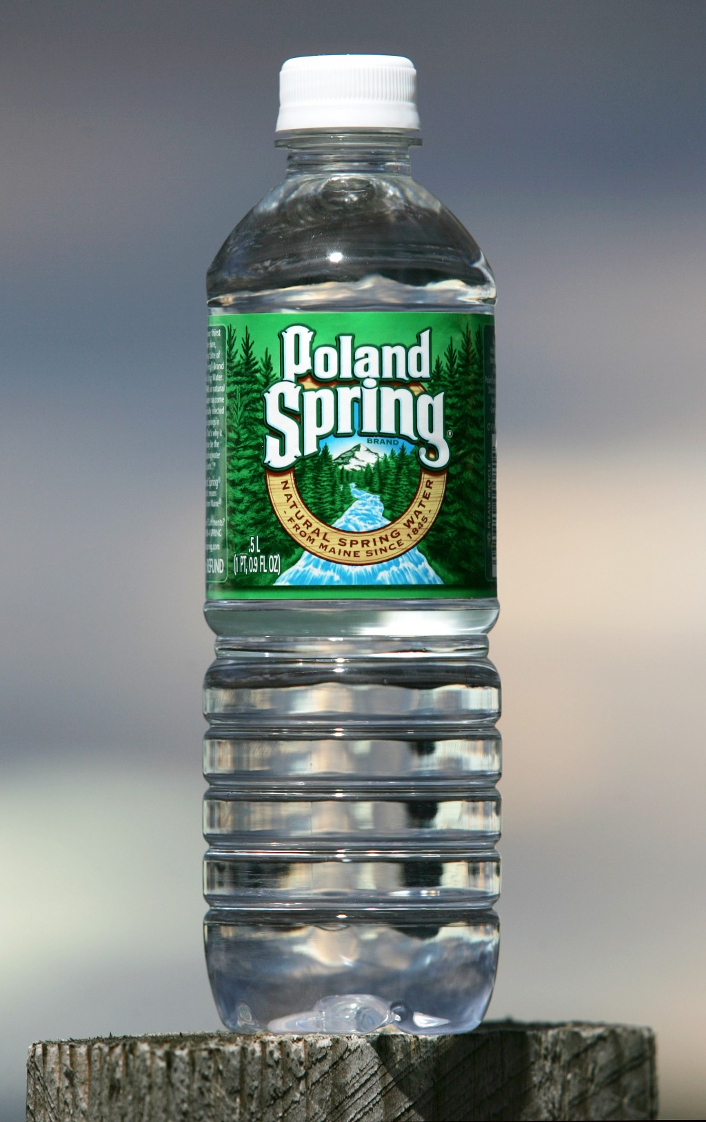 FILE - This Nov. 10, 2005, file photo shows a bottle of Poland Spring water in Fryeburg, Maine. The Maine-based company announced a plan on Monday, Ju