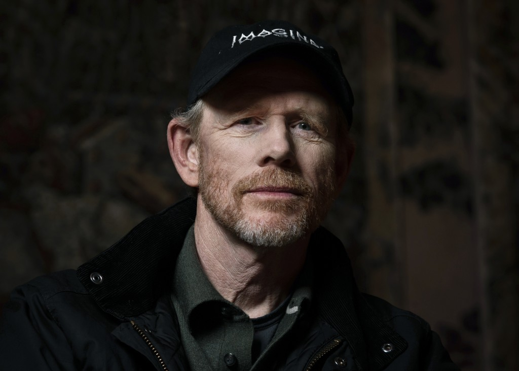 """FILE - In this April 30, 2019 file photo filmmaker Ron Howard poses for a portrait in New York to promote his documentary """"Pavarotti.""""  Howard says he..."""