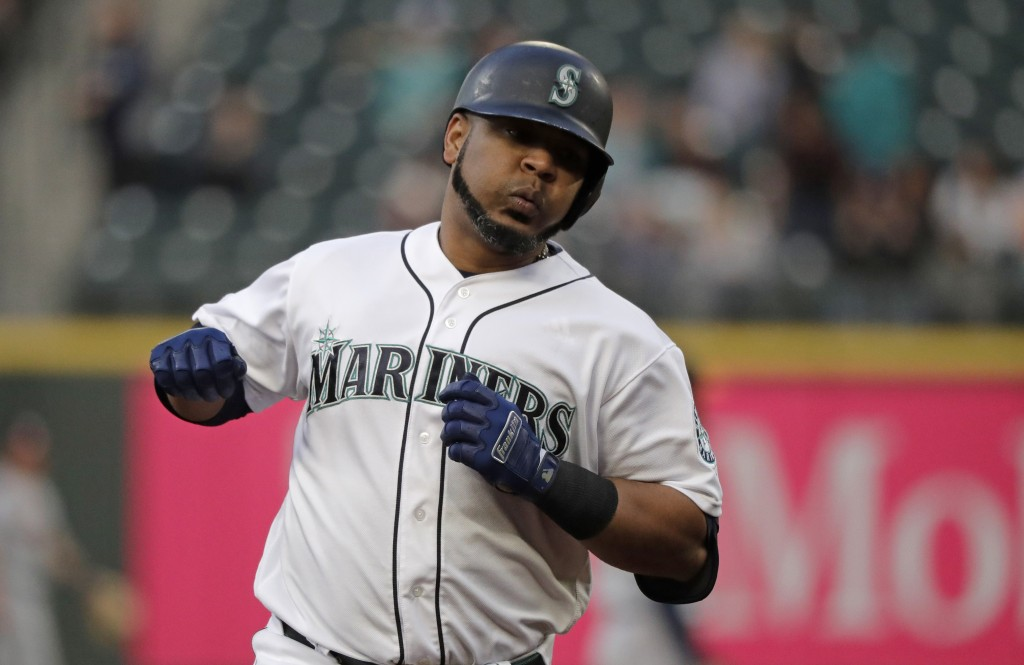 Seattle Mariners' Edwin Encarnacion rounds the bases after hitting a solo home run against the Houston Astros during the third inning of a baseball ga