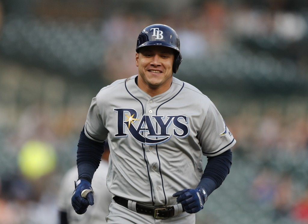 Tampa Bay Rays' Avisail Garcia rounds the bases after a two-run home run during the third inning of the team's baseball game against the Detroit Tiger...