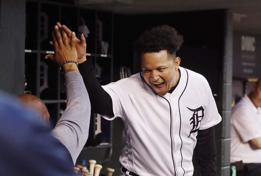 Detroit Tigers designated hitter Miguel Cabrera greets a teammate after hitting a grand slam during the fifth inning of the team's baseball game again...