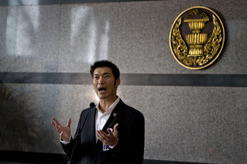 Thanathorn Juangroongruangkit, leader of Future Forward Party, speaks to journalists as Thai lawmakers gather in the same building to vote for a new o...