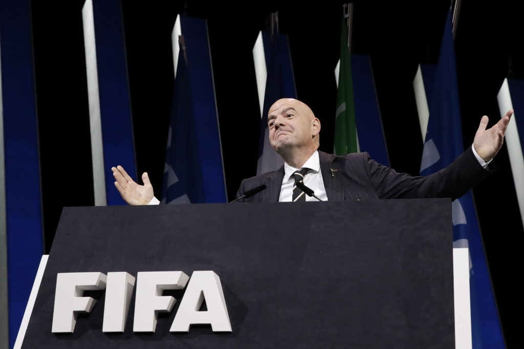 FIFA President Gianni Infantino gestures as he walks on the stage before the start of the 69th FIFA congress in Paris, Wednesday, June 5, 2019. (AP Ph