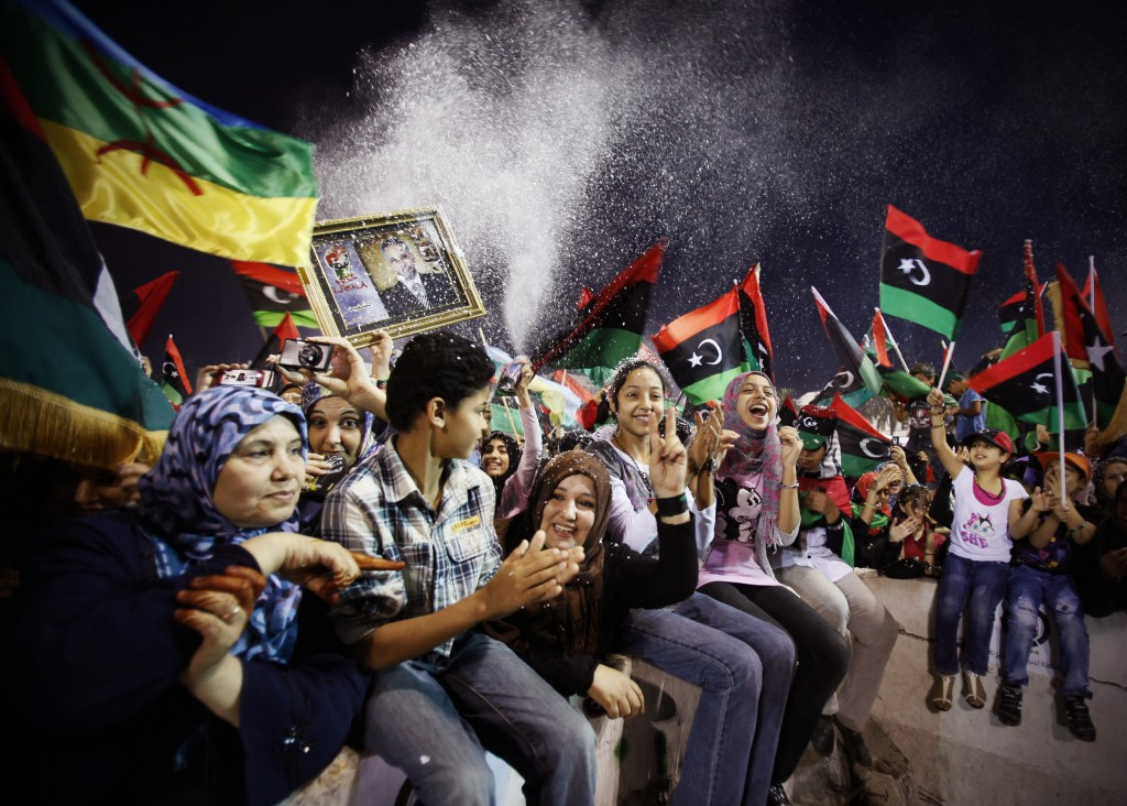 FILE -  In this Sunday, Oct. 23, 2011 file photo, Libyans gather during the celebration of Libya's liberation at Martyrs Square in Tripoli, Libya. In ...