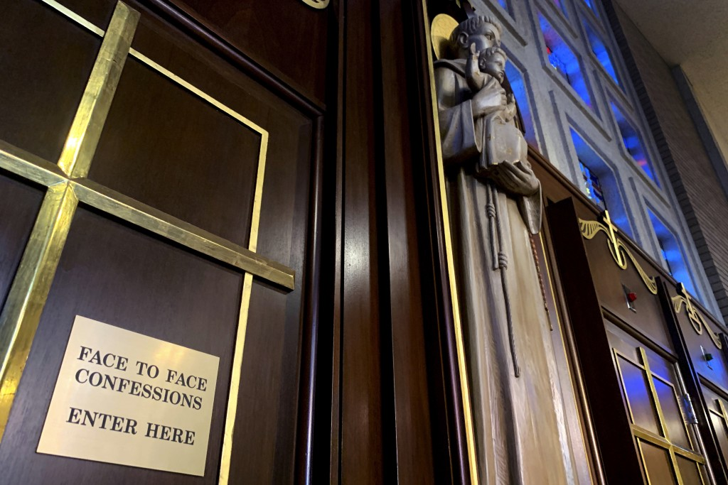 Gold crosses and statues adorn confessional rooms at St. Michael Archangel Catholic Church, one of Houston's wealthiest parishes, on April 13, 2019. L...