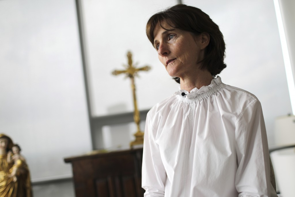 Laura Pontikes pauses during an interview in the prayer section of her apartment in Houston on April 13, 2019. The 55-year-old Texas construction comp...