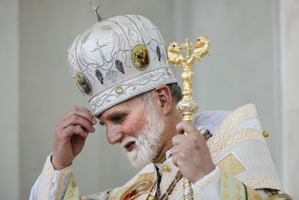 Newley installed Metropolitan Archbishop of the Ukrainian Catholic Diocese of Philadelphia Borys Gudziak blesses himself during a ceremony enthroning ...