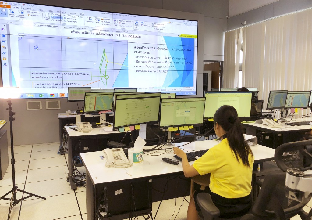 In this May 21, 2019, photo, staff monitor fishing vessels in real time at a state-of-the-art surveillance center in Bangkok, one of seven in the Asia...