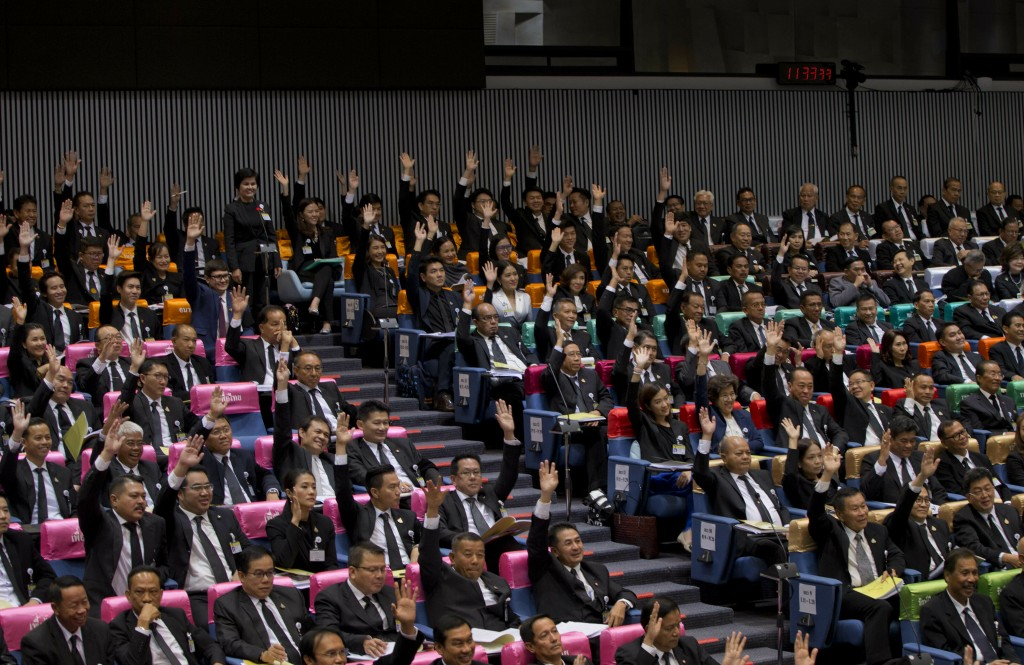 Members of the anti-military political parties raise their hands approving the nomination of Thanathorn Juangroongruangkit, leader of Future Forward P...