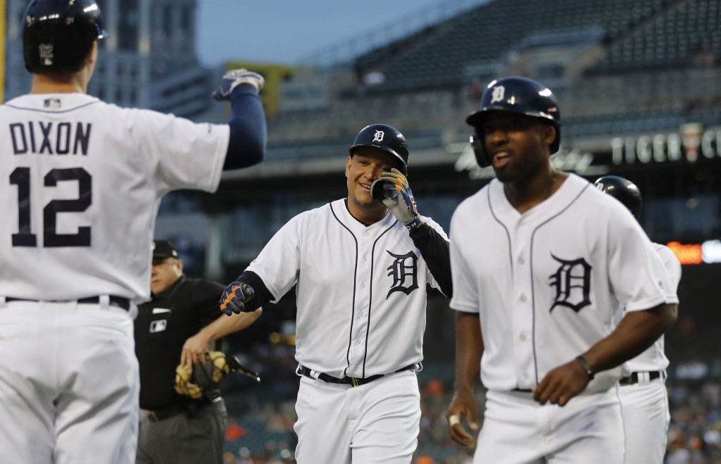 Detroit Tigers' Miguel Cabrera, center, walks to the dugout after hitting a grand slam during the fifth inning of the team's baseball game against the...