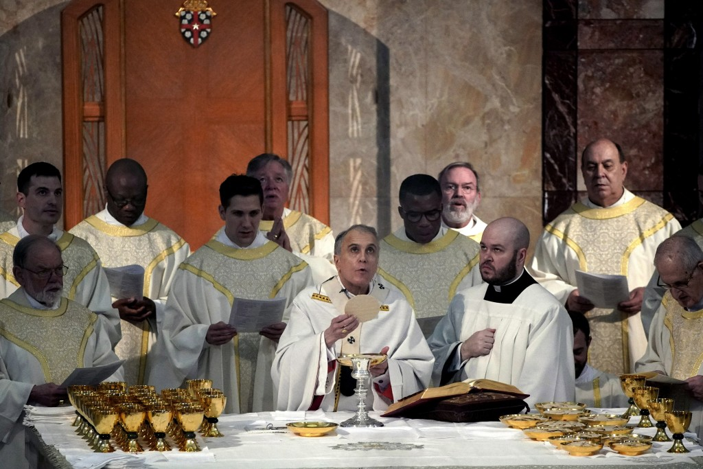 Cardinal Daniel DiNardo presides over a Mass of Ordination for seven candidates for the priesthood at the Co-Cathedral of the Sacred Heart in Houston ...