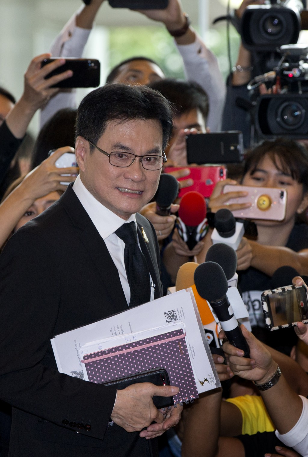 Thailand's Democratic Party leader Jurin Laksanawisit arrives to participate in the session of the parliament in Bangkok, Thailand, Wednesday, June 5,...
