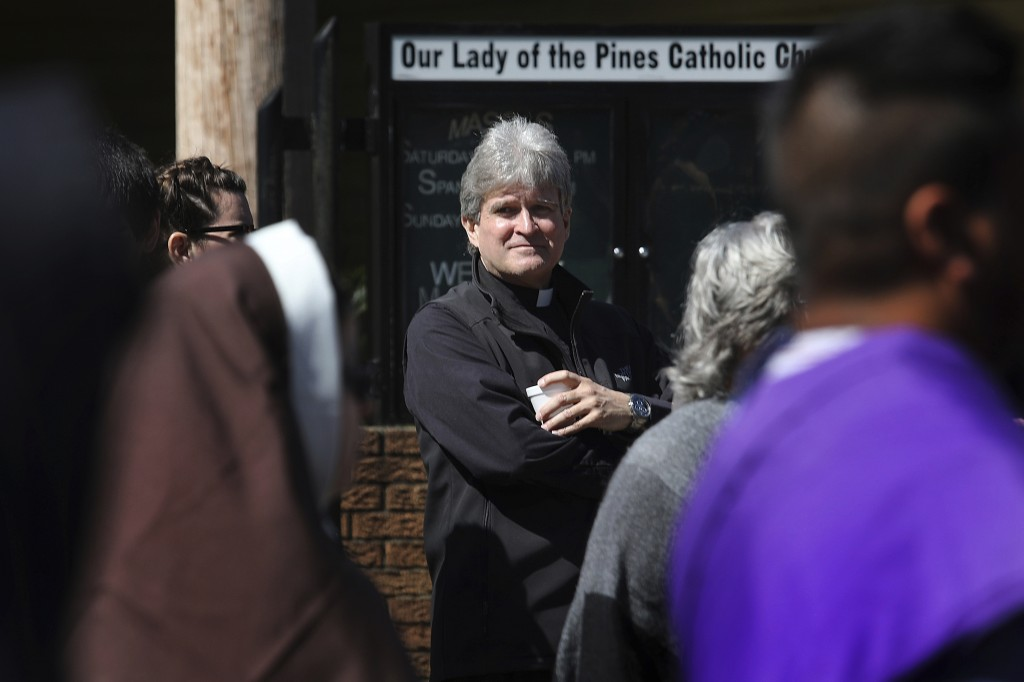 Monsignor Frank Rossi stands outside Our Lady of the Pines Catholic Church in Woodville, Texas, on Sunday, April 14, 2019. The Galveston-Houston archd...