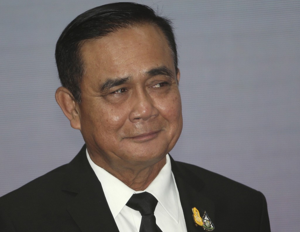 Thailand's Prime Minister Prayuth Chan-ocha smiles after his speech for the opening ceremony of Anti-Human Trafficking Day in Bangkok, Thailand, Wedne...