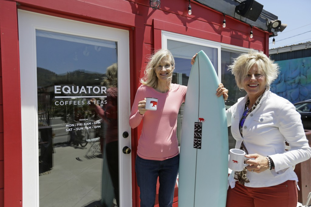 In this Tuesday, June 4, 2019, photo Helen Russell, right, and her partner Brooke McDonnell, co-founders of Equator Coffees, pose at their first cafe